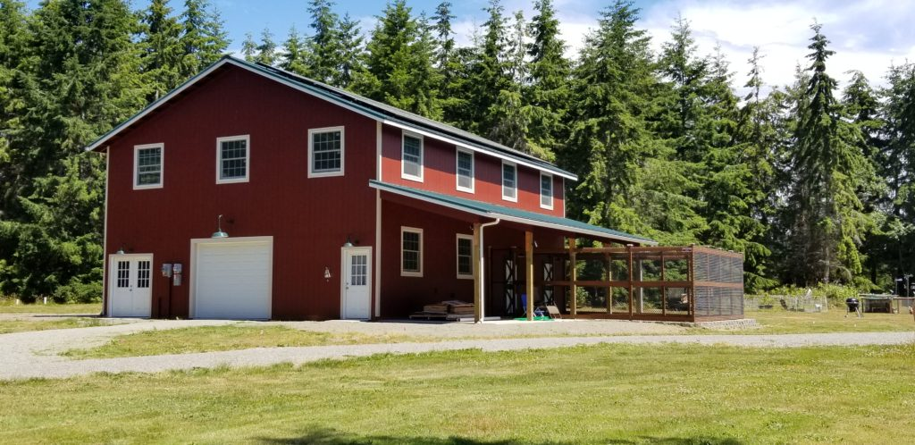 34. Two-story barn with solar panels, kennels and fenced dog run